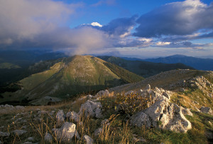 Sunset view of mountain ridges in the Central Apennines rewilding area in Italy.