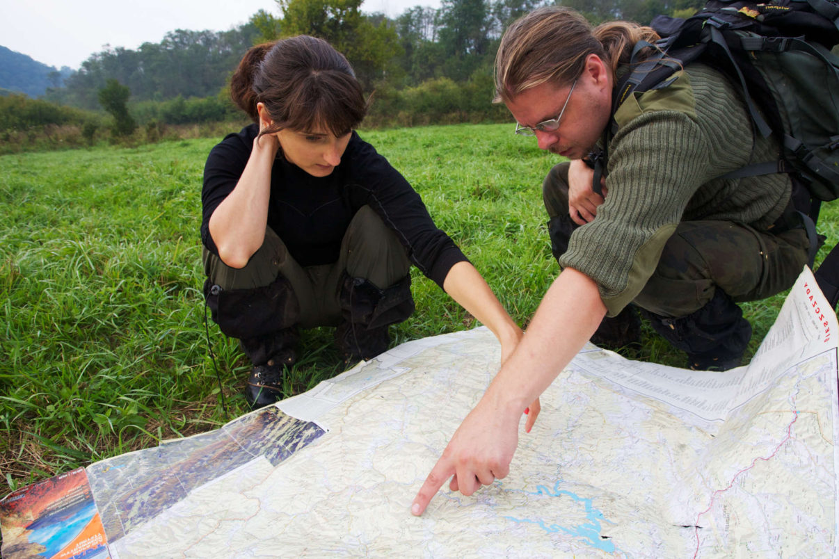 European bison or wisent researchers Aleksandra Woloszyn-Galeza and Maciej Januszczak from the Carpathian Wildlife Research Station showing the territories of two main bison herds in Bieszczady National Park on a map