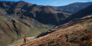 Mountain biker riding the slopes of the Tarcu Mountains Natura 2000 site. erin, Romania.