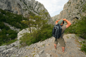 Davor Krmpotić doing field work in Velebit Nature Park, Velebit Mountains rewilding area, Croatia.