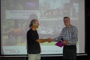"Leo Linnartz, one of the authors of ""Rewilding horses in Europe"" handed over the first copy of the study to Eurosite Secretary David Parker."