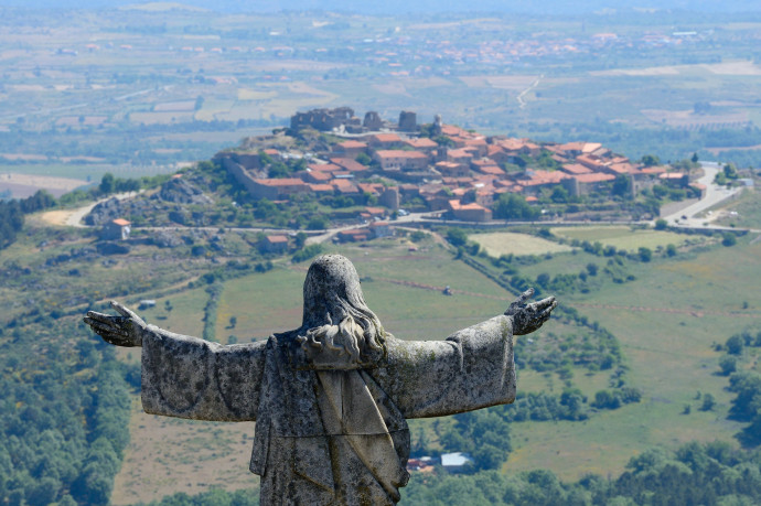 Castelo Rodrigo village, Portugal, with the statue of Christ redentor in front.