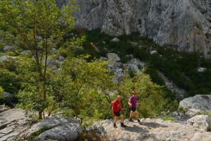 Hikers in the  Paklenica National Park, Velebit rewilding area, Croatia.