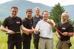 Opening the gates of rewilding zone. By order from left: Petru Vela, Mayor of the Armenis Municipality, Adrian Hagatis, Rewilding Europe's Team Leader for the Southern Carpathians , Wouter Helmer, Rewilding Europe's Rewilding Director,  H.E. Matthijs van Bonzel, Ambassador of the Kingdom of the Netherlands to Romania and Joep van de Vlasakker, Rewilding Europe's Wildlife Advisor  / Photo by Catalin Georgescu