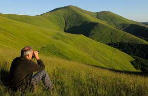 Wouter Helmer, Rewilding Director, at the Alpine grasslands in the Tarçu Mountains Natura 2000 site in Southern Carpathians rewilding area, Romania.