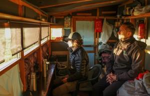 Rewilding Europe team members inside the wildlife watching hide in Khumo, Finland.
