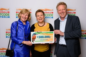 Lena Lindén (Board member, Rewilding Europe) and Frans Schepers (Managing Director, Rewilding Europe) receiving the donation cheque from Margriet Schreuders, Head of Charity of the Dutch Postcode Lottery.
