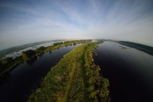 Peene river and flooded lands near Anklamer Stadtbruch, Oder Delta, Germany.
