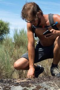 Tom Verhoeve examining rabbit droppings he found in Faia Brava.