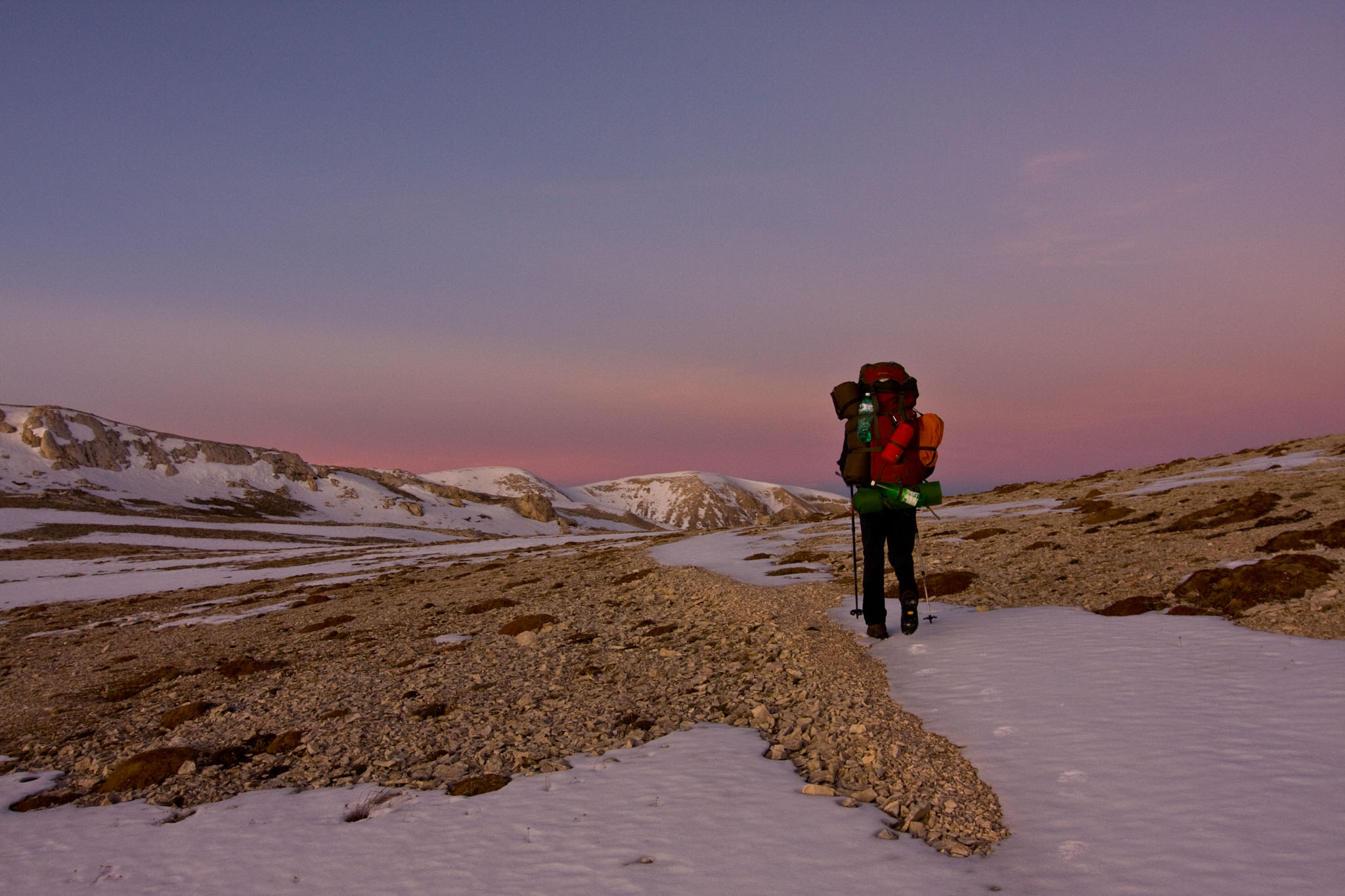 Hiker on Majella's altitude plateau. Abruzzo, Central Apennines, Italy. Oct 2009