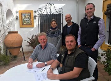 Frans Schepers, Rewilding Europe's Managing Director (left) and Massimiliano Biasioli, SKUA Nature Group's Managing Director, signing the partnership agreement.
