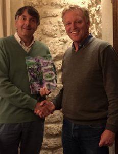 Frans Schepers, Managing director (right) handing over the first review to Wiet de Bruijn, Chairman of the board of Rewilding Europe (left).