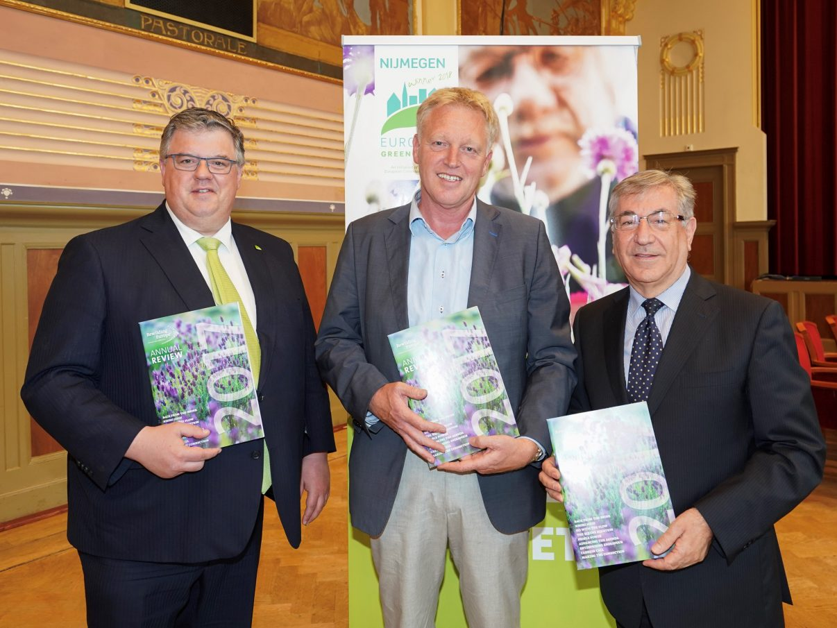 Frans Schepers, Managing Director of Rewilding Europe (centre) presents Karmenu Vella, European Commissioner for Environment, Fisheries and Maritime Affairs (right) and Hubert Bruls, Mayor of Nijmegen (left) with a copy of the Rewilding Europe Annual Review 2017, prior to a ceremony announcing the European Green Capital for 2020 that took place in Nijmegen on June 21. Photo by: Jan Willem de Venster
