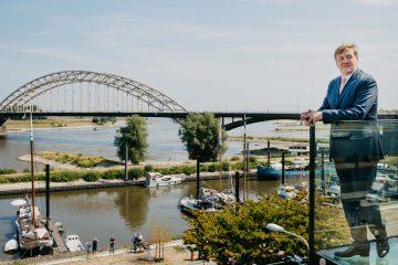 King Willem-Alexander overlooking the river Waal in Nijmegen.