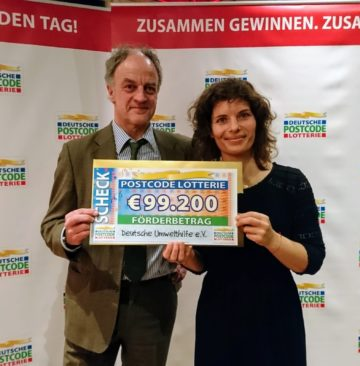 Ulrich Stöcker, head of the Oder Delta rewilding team on the German side of the delta and Gaby Schneider, Marketing Expert at DUH., receive a cheque at the German Postcode Lottery gala event in Wuppertal on January 29, 2019.