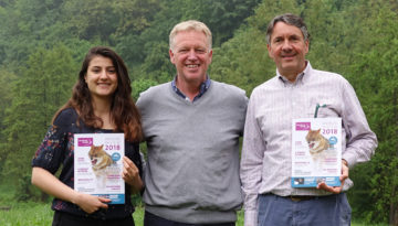 Wiet de Bruijn, Chairman of the Board of Rewilding Europe (right), and Aleksandrina Mitseva, board member (left), receive the first copies of the Annual Review from Rewilding Europe Managing Director Frans Schepers (centre).