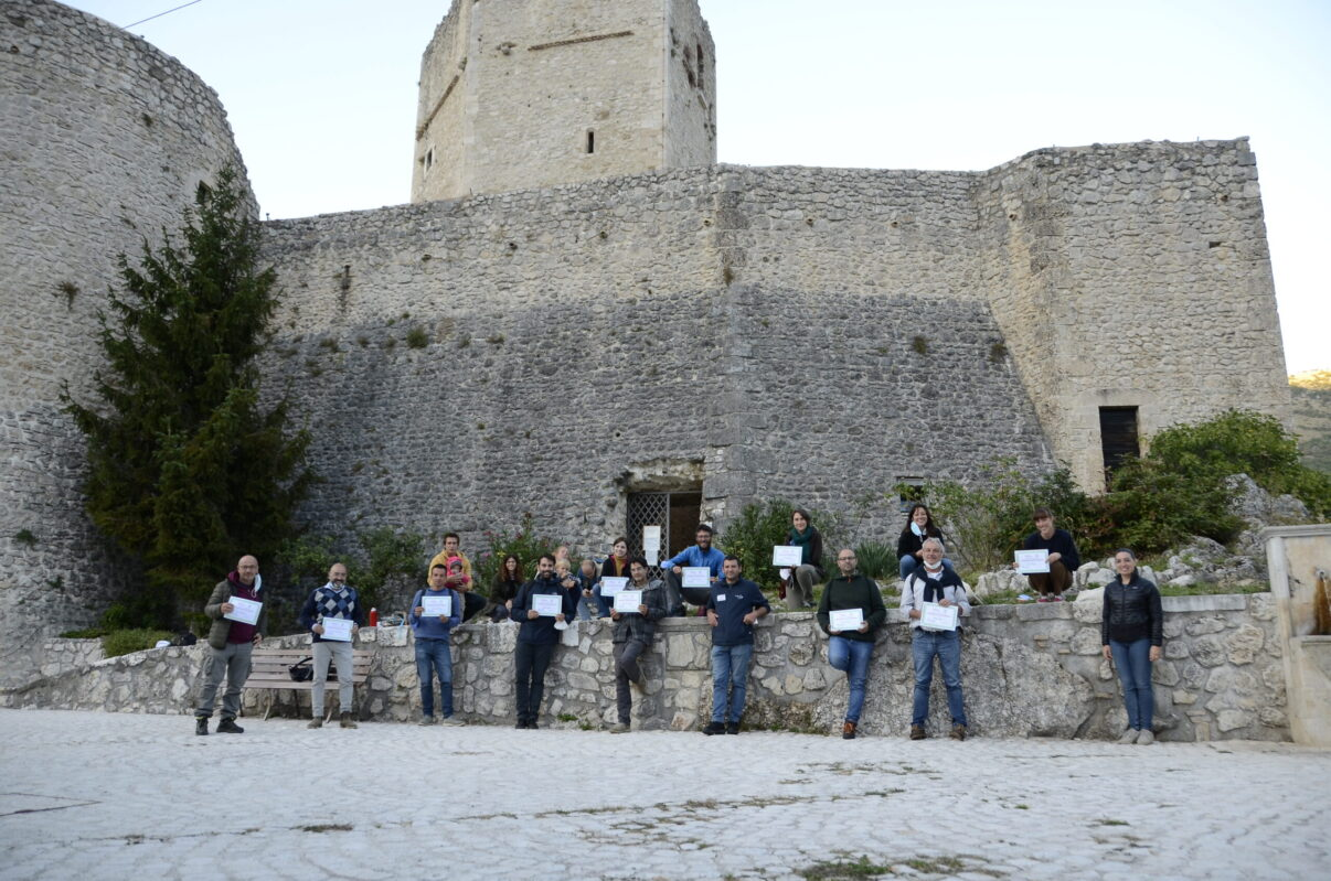 Participants and RA team outside the castle with certificates of attendance