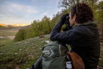 Simon Collier searching for wildlife in the Central Apennines during the Rewilding Training Tourism programme